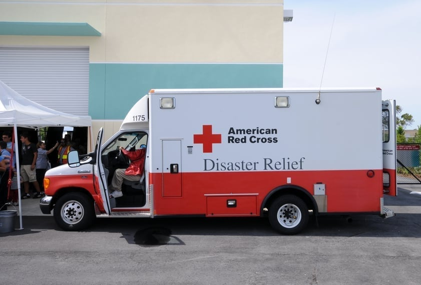 """Fort Lauderdale, USA - May 6, 2011: American Red Cross hurricane relief truck meeting the public before the start of the 2011 hurricane season. Various organization attend public events to create awareness of the forthcoming hurricane season"""